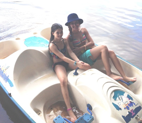 AJ and Spunky Pops on a paddle boat. We are all cheering AJ on for how far she has come - she worked her legs out!